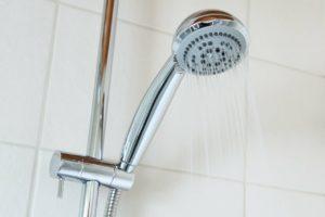 shower head , running water, pump flow rates
